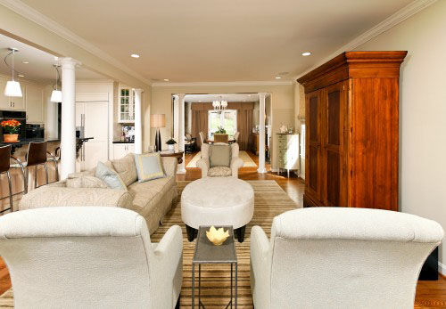 This Classic Great Room By Case Design Integrates Plenty Of Comfortable  Living Space Adjacent To The Kitchen And Dining Area. Pillars Were Added  Where The ...