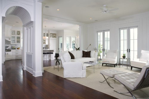 This design by Jamison Howard combines an open floor plan and plenty of  natural light with the contrast of the white interior against dark wood  floors to ...