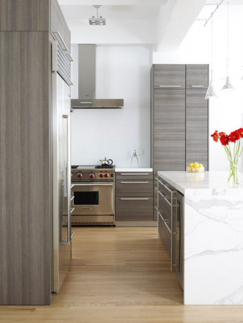 This Design By Chelsea Atelier Draws Attention To The White Marble Slab  Countertops By Blending The Appliances And Cabinetry.
