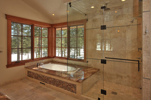 this similar setup by ward young architecture and planning has a fully enclosed steam shower that enjoys the same views as the soaking tub - Luxury Stone Showers