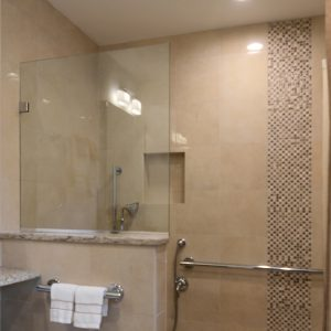 Tan tiled bathroom