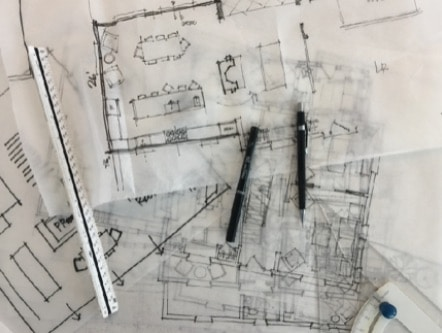 Sketches of floorplans and pens