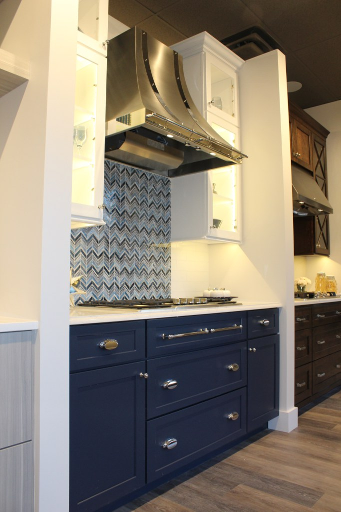 Blue cabinets and stainless steel hood