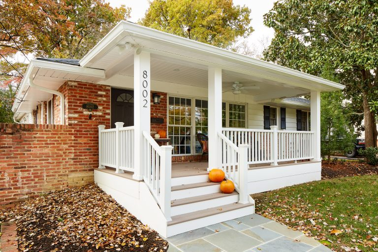 Side shot of porch with pumpkins