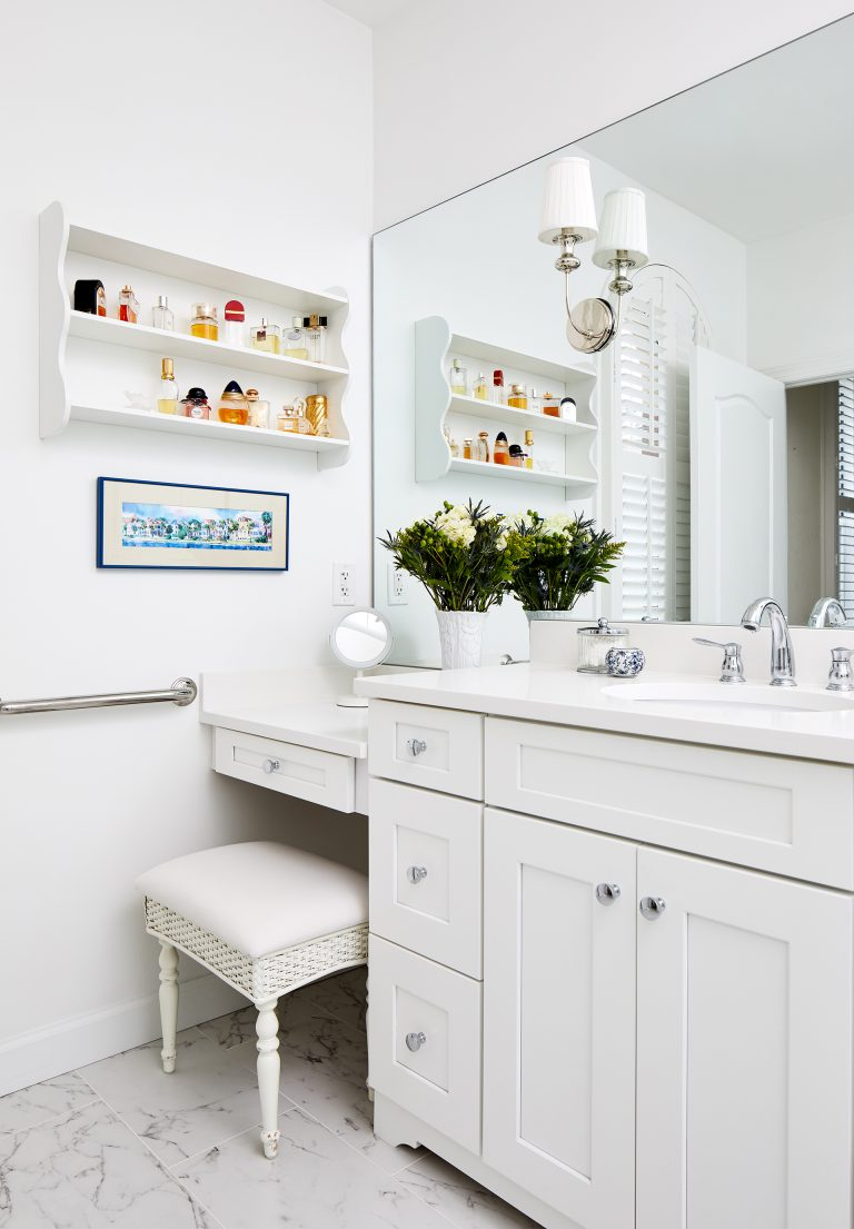 vanity with white cabinets and floating white shelf