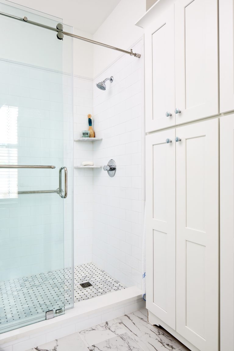 bathroom with tall linen storage cabinets in white