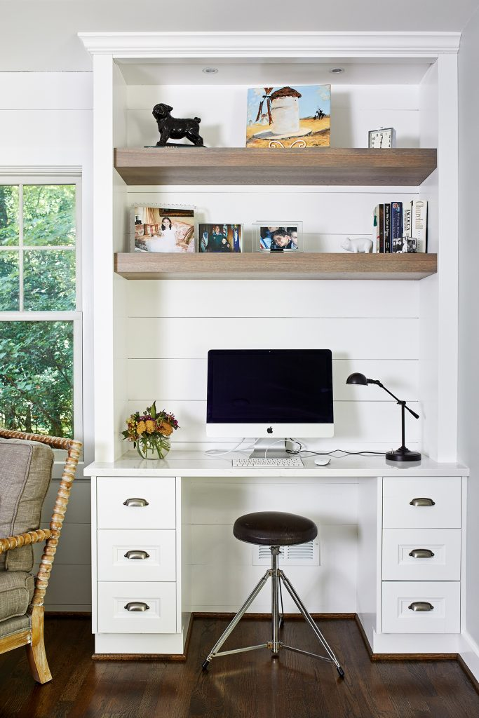 Small work desk with two wooden floating shelves