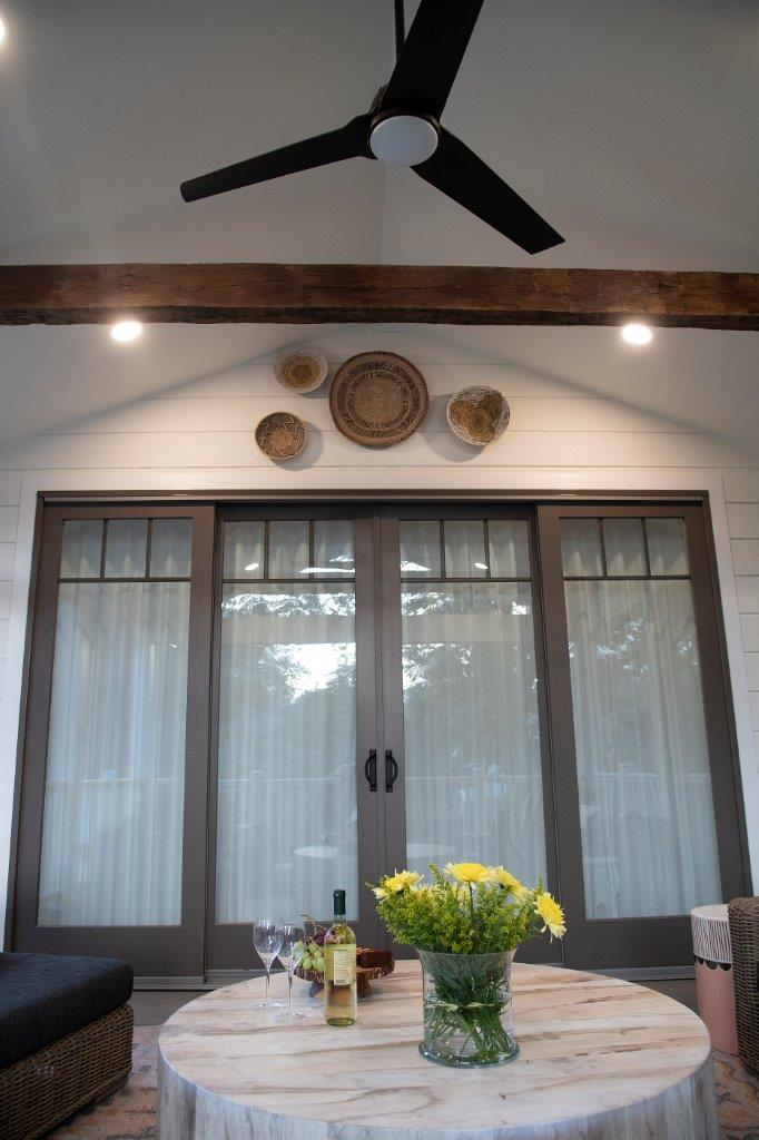 interior back patio sliding double glass doors and outdoor ceiling fan with lights