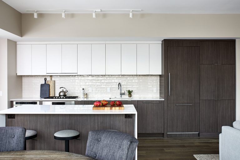 dc design kitchen with sleek and streamlined handless white cabinets with a flat smooth surface