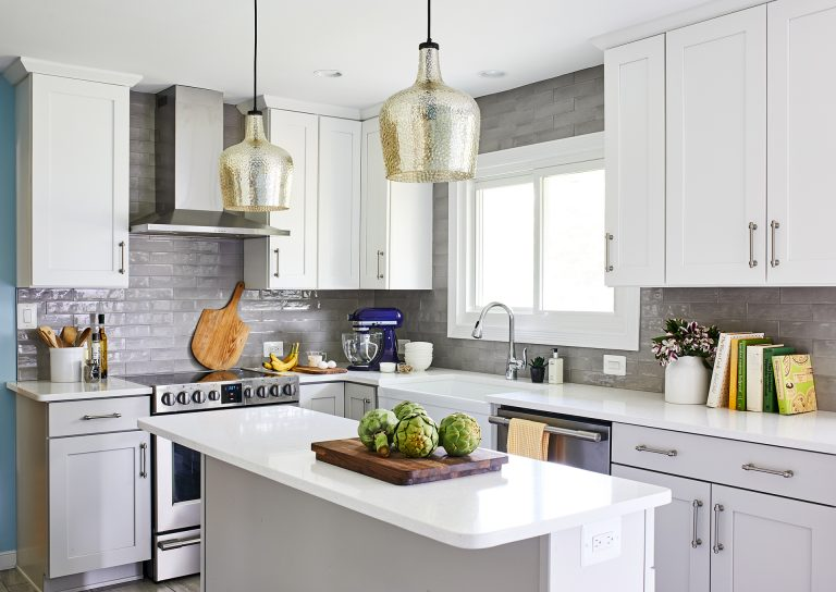 kitchen remodeling with white cabinets with pull handles, large farmhouse white sink, stainless steel dish washer and burner with hood range