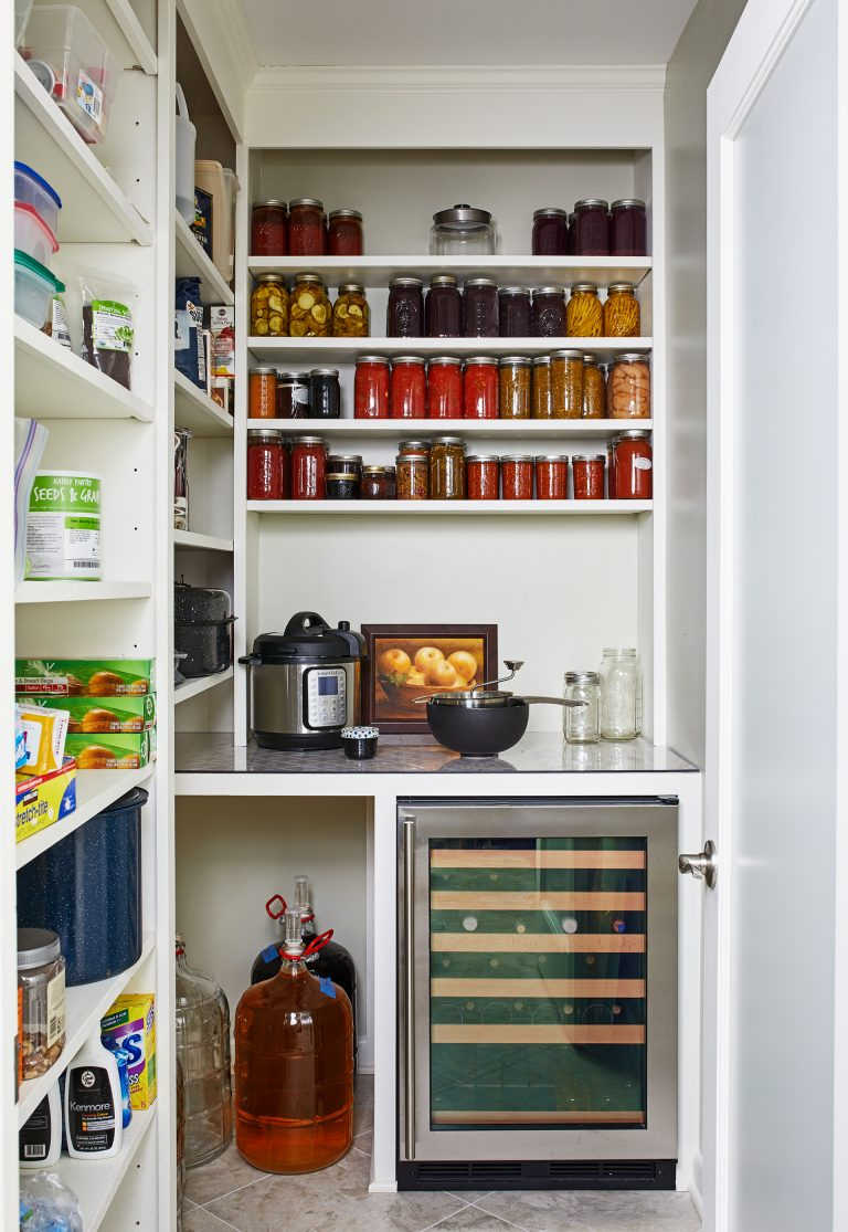 walk in pantry with counter space for smaller appliances