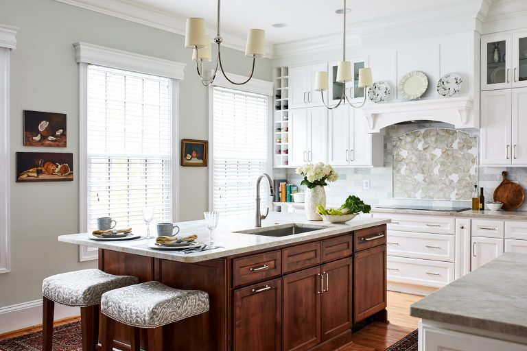 house design kitchen island facing large window with 2 chairs
