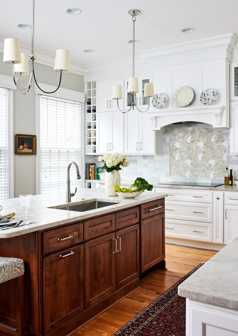 kitchen remodeling cabinetry hood with marble top island wooded floors and pendant lamps