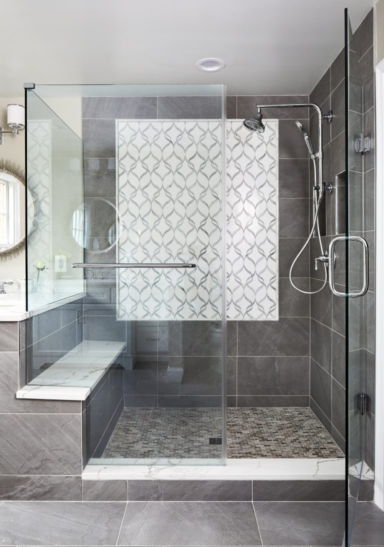 Case design remodeling master bathroom with stand up, sit down shower with frameless shower door
