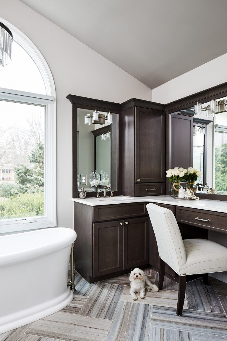 large windows in white panels with a big white tub in the middle