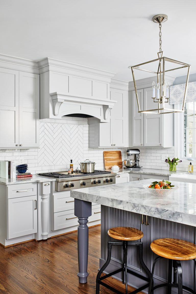 design build northern Virginia kitchen gold pendant lights over kitchen island storage and tuck-a-away seating