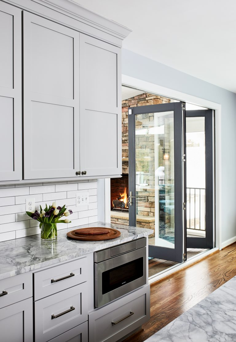 Grey frame glass double doors for dividing living room and kitchen