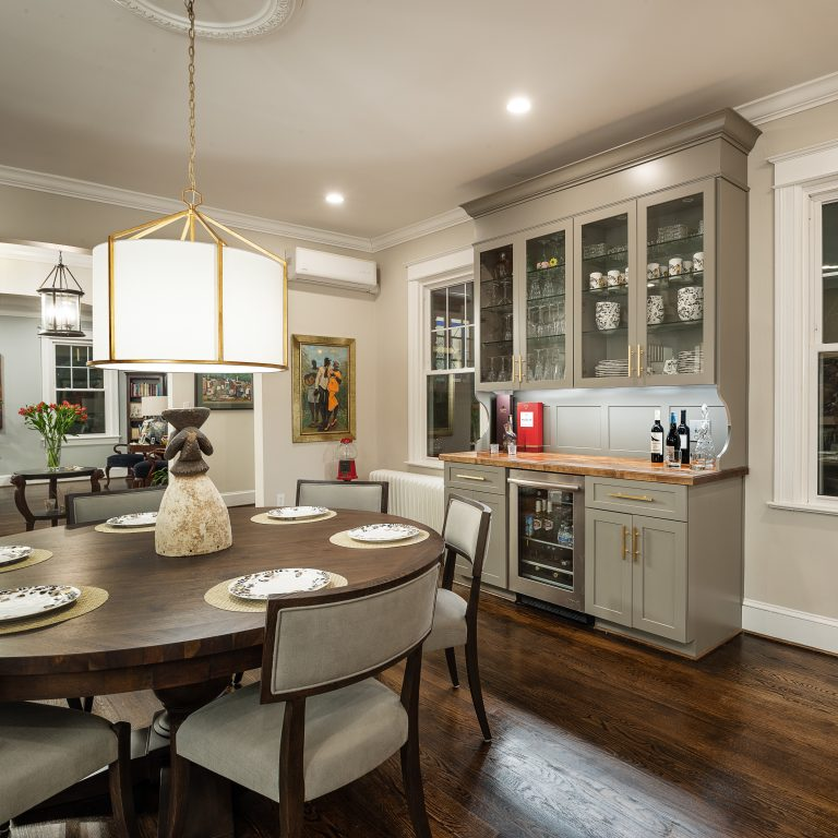 case design transitional kitchen with round dining table with hardwood flooring