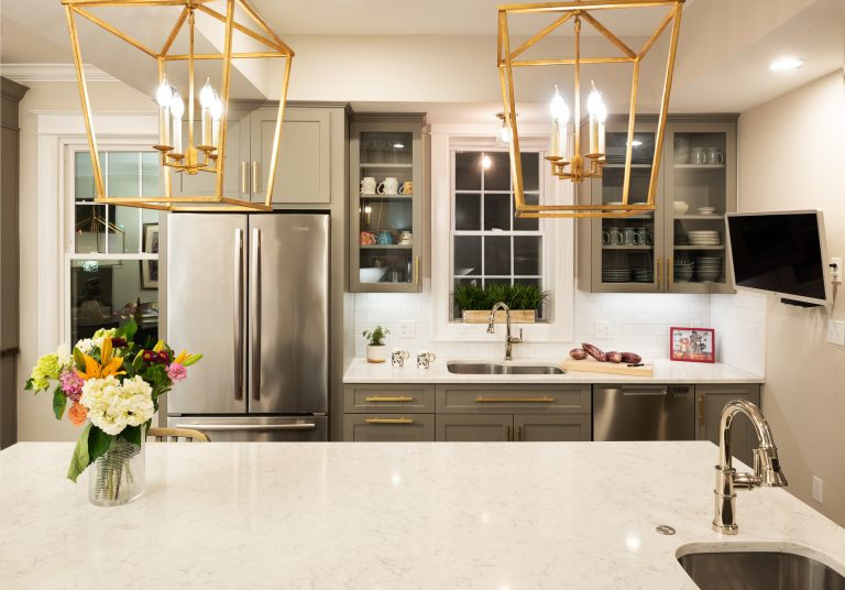 kitchen remodel dc with hanging gold lamps above island with extra sink