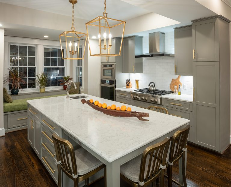 gold and white spacious kitchen island