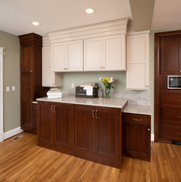 traditional kitchen with brown and white cabinets