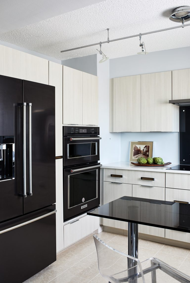 Modern Kitchen in Alexandria Virginia with black appliances and light cabinetry