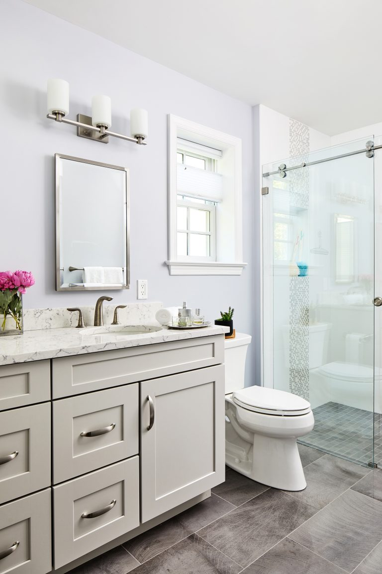 Widow over toilet design with rectangle mirror and tiles flooring
