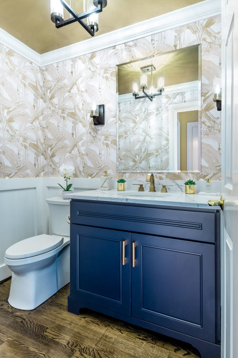 bathroom remodeling in Maryland with beautiful marble countertop with blue vanity with pull handles