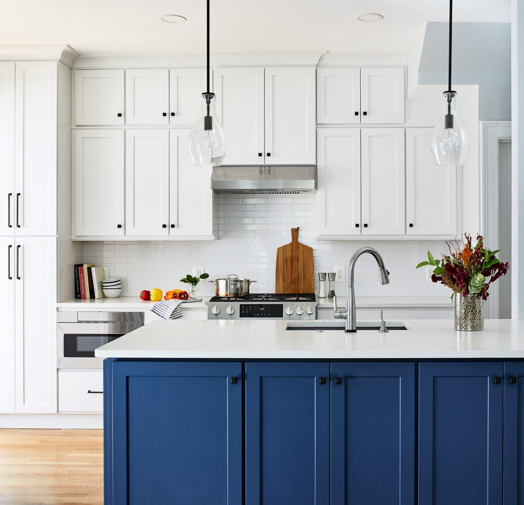 dc remodeling kitchen with white subway backsplash, two single bell pendants above kitchen island
